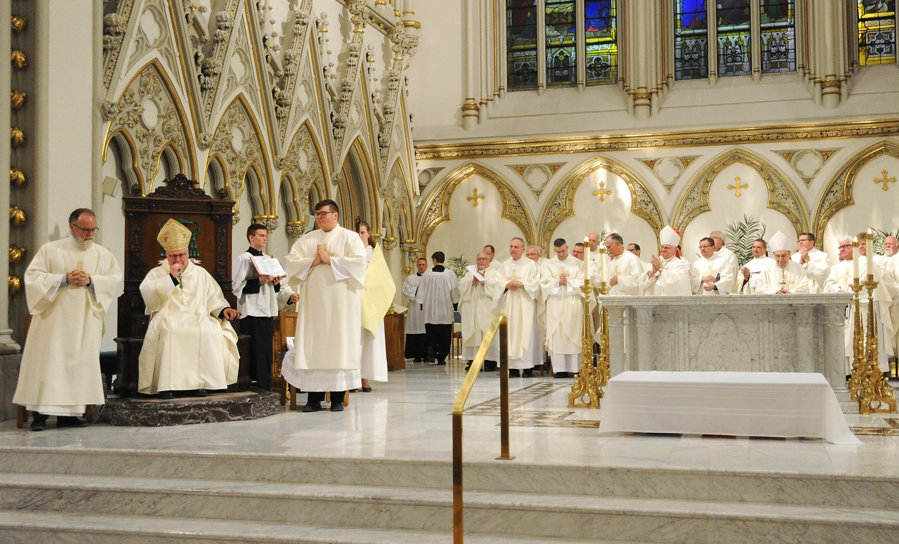 Bishop Richard J. Malone gets a standing ovation from area priests and the faithful after his homily at St. Joseph Cathedral at The Chrism Mass. Dan Cappellazzo/Staff photographer