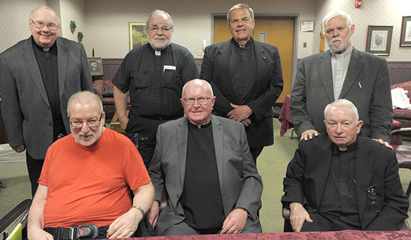 Priests from the ordination class of 1967 gather for lunch at the Brothers of Mercy Nursing Home and Rehabilitation Center in Clarence. Pictured in front (from left) are: Father Guy Siracuse, Father William Bigelow and Msgr. David Gallivan. In back are: Father Charles Zadora, Father Henry Orszulak, Father Mark Wolski and Father Robert Wild. (Dan cappellazzo/Staff Photographer)