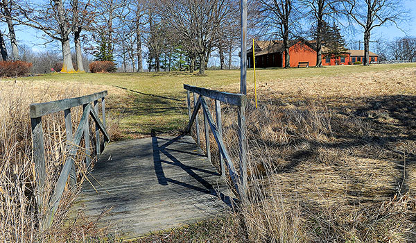 An old wooden bridge crosses a small gully along the walking path to the Abbey of the Genesee. (Dan Cappellazzo/Staff Photographer)