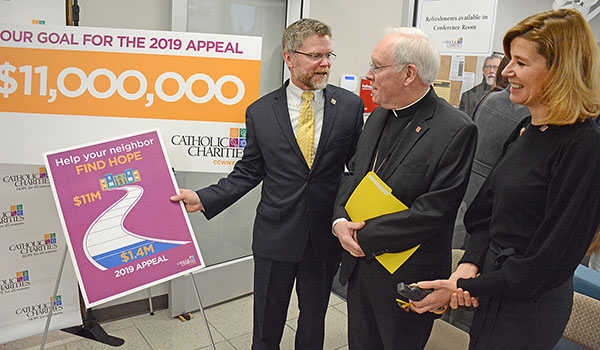 Catholic Charities 2019 Appeal chairs John and Ruthanne Daly speak to Bishop Richard J. Malone after press conference at the CC Workforce & Education Services Center at 1001 East Delavan Avenue where they announced a goal of $11 million. $1.4 million has already been raise for the 2019 `Help your neighbor find HOPE` campaign. (Dan Cappellazzo/Staff Photographer)