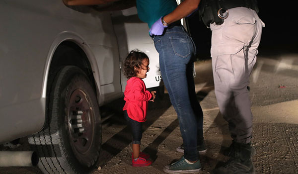A two-year-old Honduran asylum seeker cries as her mother is searched and detained near the U.S./Mexico border on June 12, 2018 in McAllen, Texas. The asylum seekers had rafted across the Rio Grande from Mexico and were detained by U.S. Border Patrol agents before being sent to a processing center for possible separation. Customs and Border Protection (CBP) is executing the Trump administration's `zero tolerance` policy towards undocumented immigrants. U.S. Attorney General Jeff Sessions also said that domestic and gang violence in immigrants' country of origin would no longer qualify them for political asylum status. (Photo by John Moore/Getty Images)