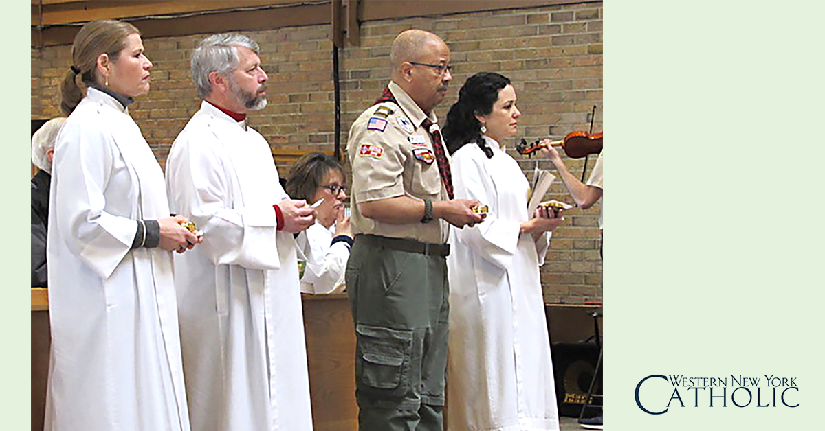 Eucharistic Ministers - Linda Wach, Don Wach, Felton Davis and Tracy Cromwell, Eucharistic Ministers at St. Bernadette's in Orchard Park, hold their pyx with the Eucharistic during at the Mass. Eucharistic Ministers bring prayers and Communion to the sick, home bound and nursing home residents. (Photo by Donna Mitchell WNYC Intern)