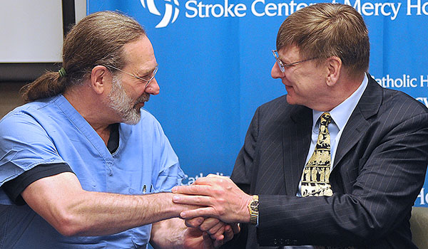 Tom Witakowski, a music professor at Buffalo State College and conductor, thanks Dr. Lee Gutermann during a press conference at Mercy Hospital. The doctor was part of the stroke team that saved his life. May is National Stroke Awareness month. (Dan Cappellazzo/Staff Photographer)