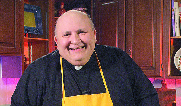 Father Paul Seil will be the guest of the Daily Bread food truck at their benefit bash on Oct. 11. (File Photo)