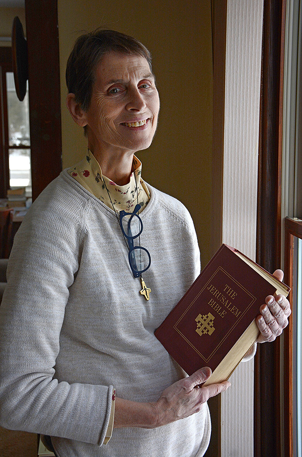 Pastoral Administrator of St.George Church, West Falls, Sister Lori High, SSMN, holds the Bible in her office. (Dan Cappellazzo/Upstart NY)