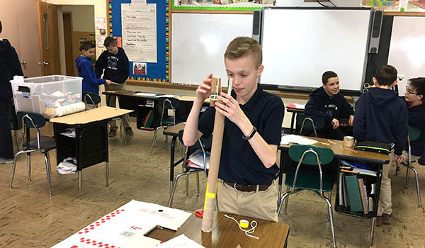 In Invention Convention Academy, Cameron Corcoran creates a device to help solve problems for someone who uses crutches. (Courtesy of St. Mary School)