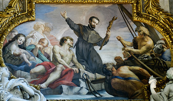 The legacy of St. Francis Xavier, depicted here holding a cross in a chapel painting in Rome, is still celebrated at St. Michael Church in Buffalo. (Wikipedia Commons)