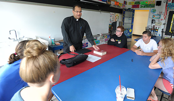 As director of Vocations for the diocese, Father Andrew Lauricella regularly meets with candidates to discern their calling. (WNYC File Photo)