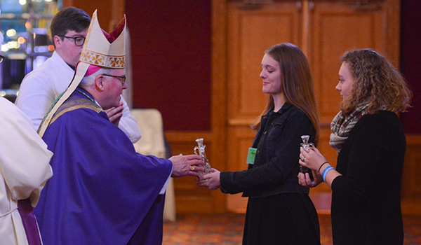 Bishop Richard J. Malone accepts the offertory during the closing liturgy of the 66th annual Diocesan Youth Convention. The convention was held over three days at the Adams Mark Hotel. (Patrick McPartland/Managing Editor)