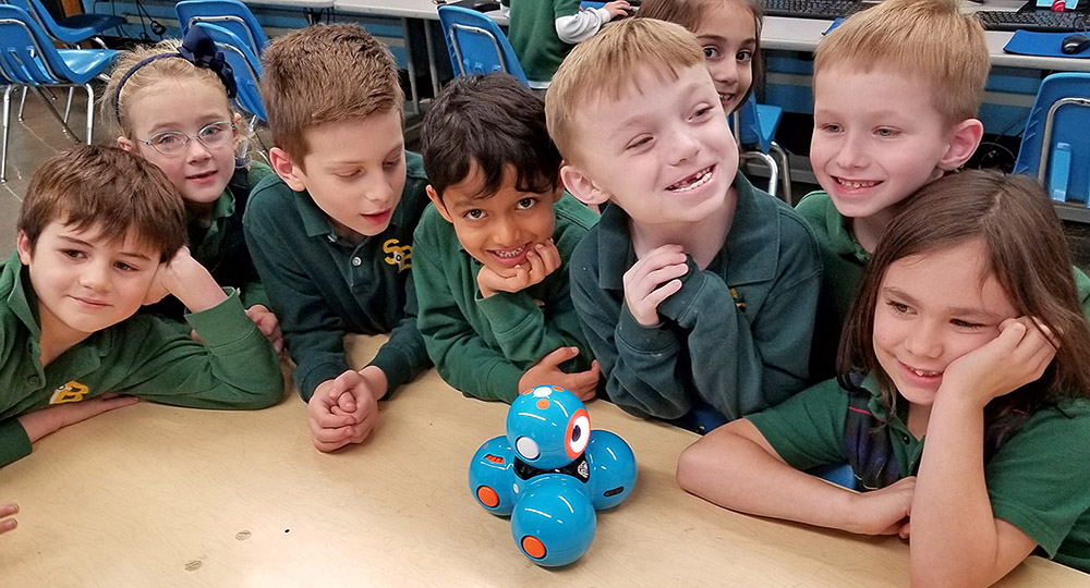 First-graders at St. Benedict School are introduced to Dash and Dot their new coding companions. (Courtesy of St. Benedict School)