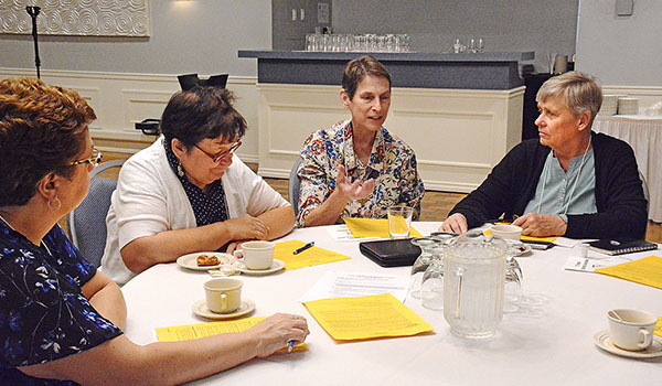 Table discussions at the Catechetical Convocation let parish leaders discuss ways already-existing small groups can effectively form missionary disciples when they intentionally share faith with each other. (Patrick McPartland/Managing Editor)