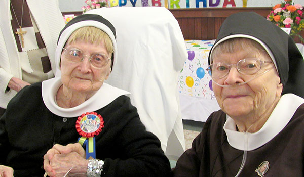 Sister Mary Fidelma Kakol, CSSF (left), celebrates her 100th birthday with her biological sister, Sister Mary Henriella Kakol, CSSF. (Courtesy of Felician Sisters)