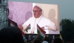 Pope Francis is shown on one of the giant video screens in Krakow